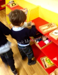 Nursery Class - busy returning work to the shelves